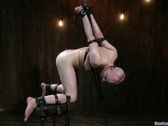 She was hanged on the chains and then waxed so bad. There was too much pain for her that she falls unconscious. Like this BDSM porn video?