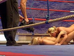 Attractive blonde hotties Kathia Nobili and Brandy Smile with delicious asses and natural boobs get naked during rough fight and start licking each other on the floor in ring