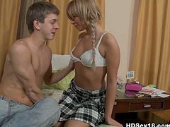 This naughty blonde schoolgirl lays on the bed with her boyfriend and after some chatting, he undresses her and licks her pussy then fucks her hard.
