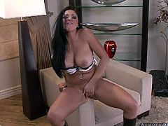 Arousing brunette beauty with big tits enjoys deep drilling her twat with her new glass toy