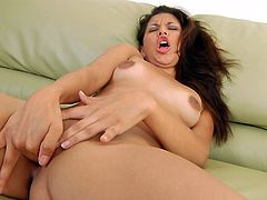 Amazing hottie likes posing her shaved cunt while being deep finger fucked