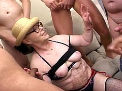 Spoiled brunette granny with slack old body and oversize knockers and her ruined pussy is gangbanged by six horny guys,She bends over and sucks a hard dicks while another dude is poking her old pussy hole from behind.Enjoy!
