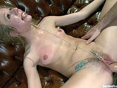 Gorgeous Chastity Lynn gets tied up, gagged and clothespinned. After that she lies gets fucked and fisted on a sofa.