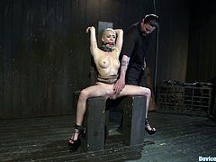 Horny blonde chick sits on a special chair being clothespinned and tied up. After that she gets toyed with big dildos.