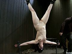 There's going to be extreme bondage in this video with the brunette girl who gets hung upside down in the BDSM clip.