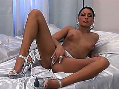 Tall, long legged and model-quality brunette Aneta Keys rubs her beautiful shaved pussy with her fingers and moans sweet! After that she makes a metallic dildo wet with her sucking mouth!