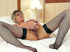 Sexy and old granny named Jessye plays with her pussy and gets pleasure