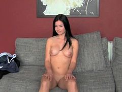 Two lovely brunette girls strip their clothes off and then kiss each other. After that they finger their hot pussies.