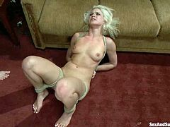Superb blonde girl lies naked on a bed being tied up. The guy toys her pussy and hits with electricity. After that he destroys her ass with his big dick.