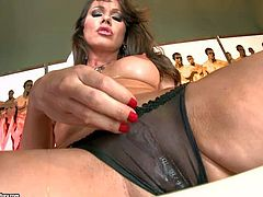 Sandy is a brown haired lovely lady in see-trough black panties and shoes. This stunning woman spreads her legs and gets her pussy out before she fills her pink hole with her fingers.
