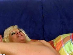 Horny as hell older blonde Orhidea fucks her lose pussy with red dildo before she gives it to hot guy. He licks her mature snatch and she sucks his dick like theres not tomorrow.