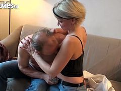 Sexy girl kisses with a guy and then gives him a blowjob. After that she lies down on a sofa and gets her pussy torn up.