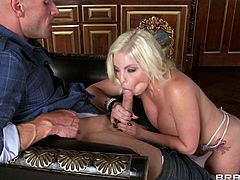 Sexy pornstar Britney Amber loves to suck big, hard cock. She unzips Johnny Sins' pants to unleash his snake. She wraps her hands and lips around it and works them both at the same time. She uses lots of spit and tugs on the balls.