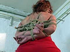 Tied up Angelina Blue gets her butt touched by mistress