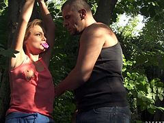 A beautiful babe is kidnapped by a crazy kinky couple and taken to the woods where they tie her up to ride her.