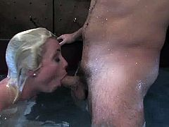 Hot blonde girl undresses and then gets toyed. After that she gives a blowjob to her Master. Then she gets pounded in water.