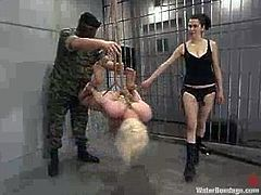 Nasty blonde Lorelei Lee lets Sgt. Major and his assistant bind and suspend her in a jail. She gets her holes toyed and can't help but moan sweetly.