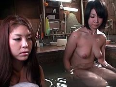 Two hot Japanese women are having some good time in a bathroom. They look at each other's nude bodies and play with their pussies.