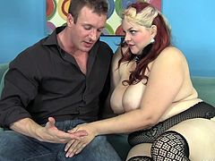 If this fat redheaded bitch agrees to suck on TJ Cummings's cock she will be rewarded handsomely with some cash. Her fat is pushing through her fishnets. He measures her hips and waist; she is absolutely huge.