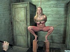 Get a load of this blonde slave's sexy body in this bondage clip where she deep throats her master's big cock while being tied up and helpless.