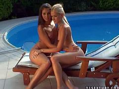 Smoking hot black haired babe Melissa with dark make up and great hunger for pussy pleasures her adorable blonde girlfriend and share double dong with her outdoor by the pool
