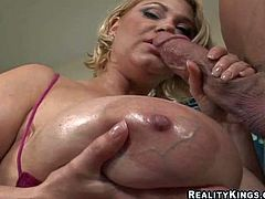 Short haired happy cock addicted mature blonde Samantha with gigantic natural gazongas in cheep slutty outfit teases handsome stud Billy Glide and takes on his stiff bazooka with great passion
