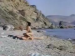 In this classic greek porn brunette wifey takes it on the seashore! First, she sucks on his cock and then rides it like a nympho!