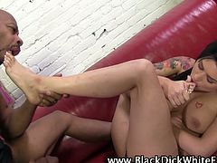 Eva Angelina is giving this black due a footjob and gets his cock nice and hard and he cums all over her feet.