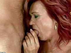Mature redhead whore with hanging tits and nice oral skills gets her cunt pounded hard by young turned on buck and takes on his cock like there is no tomorrow