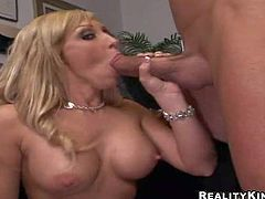 Arousing long haired blonde Jessica Lynn with jaw dropping hooters and amazing oral skill in stockings only gets down and gives memorable blowjob to Billy Glide in the office