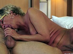 A randy short haired mature whore rides her nephew's buddy in her hotel room and munches his cum.
