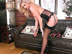Watch the nice masturbation from very beautiful girlie Danielle Maye. She is staying in corset, stockings and high heels all in black color before starting to rub twat.