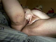 This big fat bitch is getting fucked doggy style but it wasn't enough for her and she takes matters in hand and starts fingering her shaved slit to try and get off.