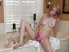 Having huge dildo up her tight vag makes blondie to go wild and naughty