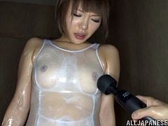 Japanese hottie gets her pussy toyed to orgasm indoors