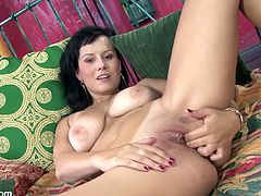 Get a load of this gorgeous brunette in this solo scene where she shoves her fingers into her tight pink pussy as she plays with her huge tits.