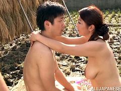 Experienced Japanese woman toys her pussy with a cucumber in a field. After that she gives a blowjob to some guy and gets fucked hard.