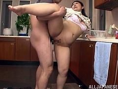 Asian girl washes the dishes. Her husband comes up to her and start to lick her vagina. After that she gets fucked from behind.