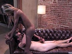 Dietrich Cyrus is having fun with nasty ebony tranny Mistress Soleli. They play with each other's schlongs and then Dietrich gets his asshole pounded from behind.