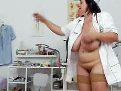 Black haired donna practical nurse teases in uniforms