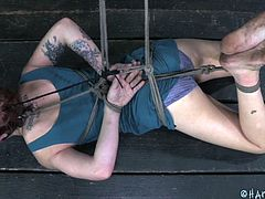 These country girls, they are so fucking hot and naughty! This one over here messed with the wrong people and now she's all tied up in this barn awaiting to be used. Look at her laying on that floor powerless and then how she stays on that chair ball gag and with her thighs spread. What will happen to her?