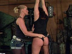 Arousing blonde bitch Kathia Nobili with smoking hot body and heavy make up in pantyhose and denim hot pants dominates over tied up black haired babe with big juicy ass