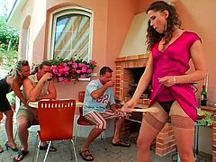 What's for to waste time on talking and drinking, when there's a great chance to have a group sex right in the yard?! Slim brunette pulls up her dress and bends over the table to be fucked from behind, while kinky brunette with sweet tits sucks a tasty lollicock passionately for sperm.