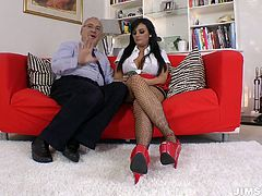 Jim Slip sex clip presents a really voracious and hot brunette babe. Kinky gal gets seduces by old man. Wearing fishnet stockings, short skirt and heels ardent gal unbuttons her blouse and plays with awesome boobs passionately. Gosh, I wish I could spend a night with such a hot babe.