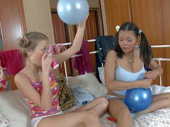 Maya and Trinity are two sweet teen friends that spend time together drinking champagne and playing with balloons in the bedroom. They do it before they get horny for each other.