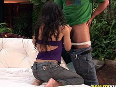 Submissive Latin hoe kneels down in front of horny dude to mouth fuck his massive hard penis welcoming oral stroking of her big cuddly tits in the interim.