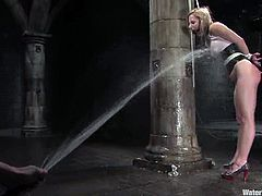 Adorable blonde girl gets tied up and then hosed with cold water. Later on the guy puts her in an aquarium.