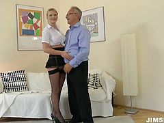 Natasha Brill is wearing pretty college uniform and black fishnet stockings. She fingers her snatch teasing the guy. Then she is nailed bad from behind.