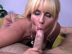 Mom Karen is a dirty slut that likes to do everything when it's about fucking. The blonde bitch is getting her big round boobs licked and that makes her so horny that she begins to suck the guy's cock and then continues by licking his ass hole. What a delicious, dirty mommy!