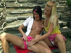This is a hardcore lesbian sex action running outdoor. Two slutty bitches are going wild and dirty. Check them out in a hot lesbian sex video.